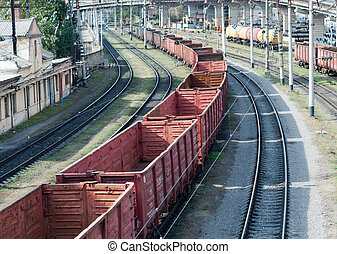 railway landscape - many railroad cars and tanks standing in...