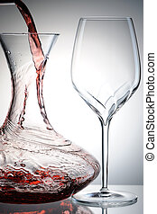 Pouring wine into decanter - Pouring red wine into decanter