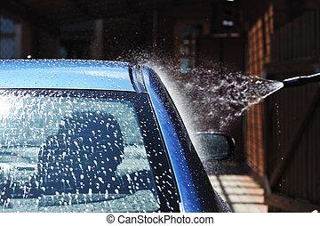 Car washing - Blue car washing on open air