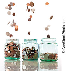 Savings concept - Savings rate concept - jars in row filling...