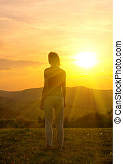 woman silhouette in the mountain at sunset
