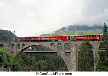 The Rhaetian Railway, Switzerland - View through a bridge...