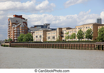 London, warehouse converted into apartments on the Thames in...