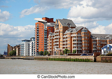 Warehouse converted into apartments on the Thames in London,...