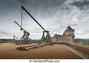 Siege catapults - Trebuchets (siege warfare). Castle of...