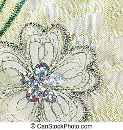 Machine embroidered flower with metallic thread and sequins