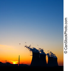silhouette of the nuclear power plant at sunset
