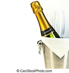 Champagne bottle in cooler and two champagne glasses