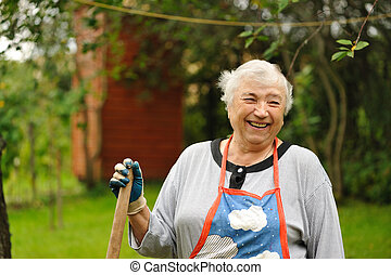 Senior woman in backyard smiling