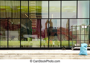 glass facade - The abstract reflection of a house facade in...