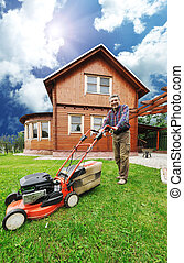 The Lawnmower Man - Senior man mowing the lawn