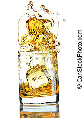 Scotch splash - Ice cube splashing in scotch isolated on...
