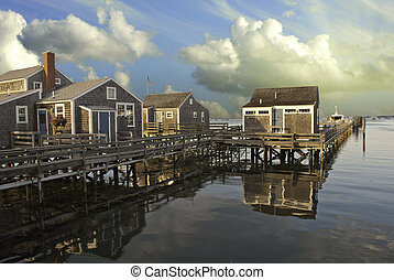 Homes over Water in Nantucket at Sunset, Massachusetts, USA...
