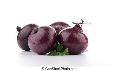 Red onion rotating on white background
