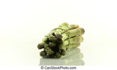 Fresh green asparagus - Rotating fresh green asparagus...