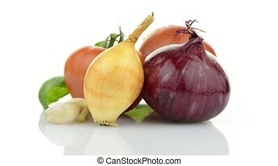 Onion, tomato and basil leaves still life rotating isolated...
