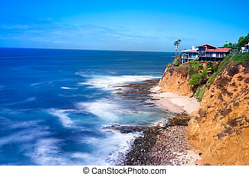 Cliffside home overlooking ocean - A scenic shot of a...