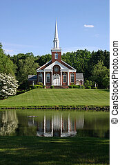Church - A beautiful church on a hillside overlooking a pond