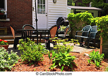 House patio with outdoor furniture and garden