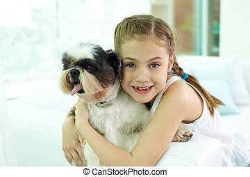 Devotion - Portrait of happy girl embracing shih-tzu dog and...