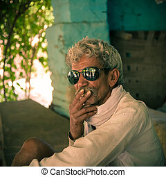 Smoking by old indian villager - Portrait of indian villager...