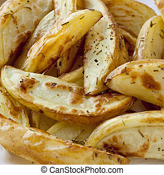 Oven Baked Potato Wedges - Oven-baked potato wedges with...