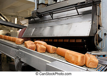Baked Breads on the production - Bread bakery food factory....