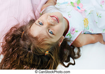 Adorable girl - Above angle of lovely girl looking at camera...