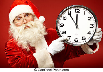 Hurry for Christmas - Photo of stunned Santa holding clock...