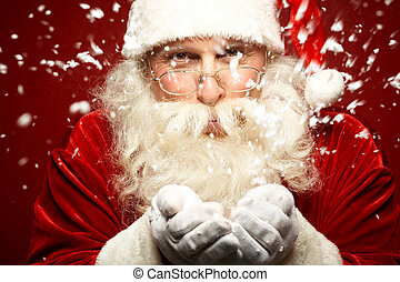 Snow blow - Photo of Santa Claus in eyeglasses blowing snow...