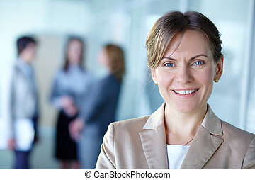 Female leader - Image of pretty business leader looking at...