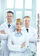 Medical team - Portrait of three doctors in uniform looking...