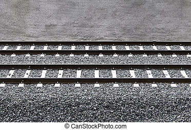 Train rails - Via train with two rails, cement and gravel on...
