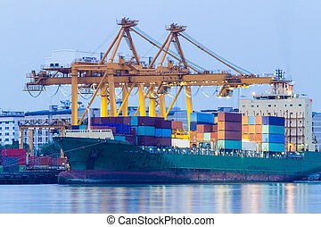 Container Cargo freight ship with working crane bridge in...