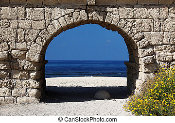 Ancient Roman aqueduct in Ceasarea at the coast of the...