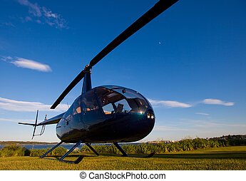 Robinson R-44 ready for takeoff in late afternoon