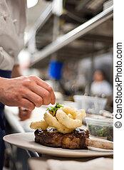 Ribeye chop - A ribeye chop being prepared in a kitchen
