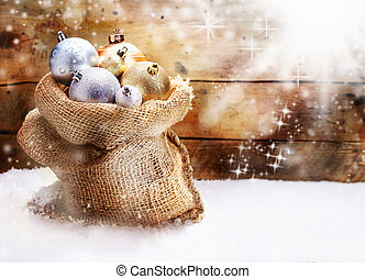 Hessian sack with Christmas baubles - Hessian sack filled to...