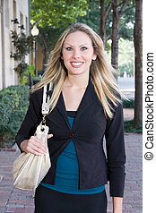 Young Business Woman Walking - Young business woman...