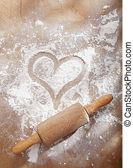 Heart in flour with rolling pin - Heart drawn in sprinkled...