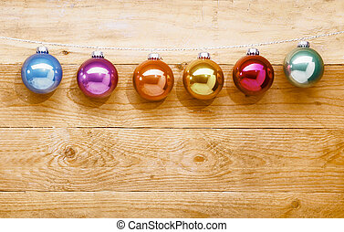 String of colourful Christmas baubles - String of colourful...