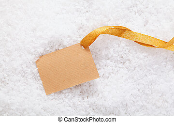 Paper label and ribbon in snow