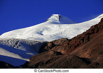 Sundown in snowy mountains Elbrus, Northern Caucasus