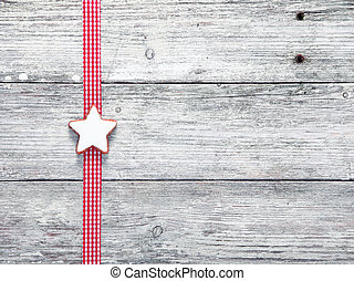 Christmas star biscuit and festive ribbon on grungy white...