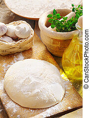 Dough and ingredients for pizza - Dough and ingredients for...