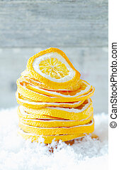 Dried orange slices in snow - Stack of colourful dried...
