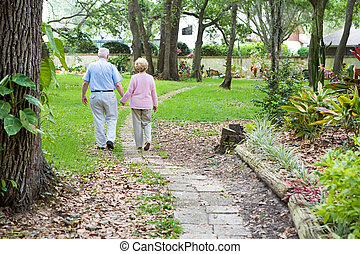 Lifes Journey Together - Senior couple strolling down a...