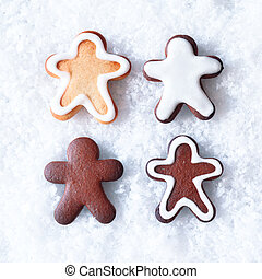Tasty Christmas gingerbread men cookies with decorative...