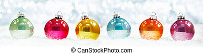 Beautiful shiny Christmas ball banner arranged in a row on...
