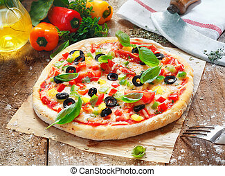 Scrumptious homemade pizza with a thick golden base topped...